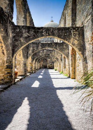 missionary: Arched walkway at the historic Mission San Jose in San Antonio, TX