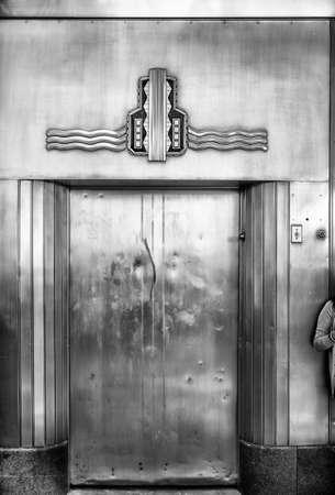 people in elevator: Retro style outdoor elevator door in Fort Worth, TX Stock Photo