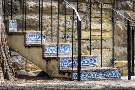 Outdoor stairway made of concrete and colorful tile inlays on the San Antonio, TX Riverwalk Stock Photo
