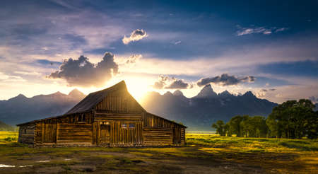 mormon: Sunset over the iconic Moulton barn on Mormon Row in Grand Teton National Park, WY