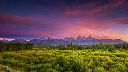 Colorful summer sunrise at Blacktail Ponds Overlook in Grand Teton National Park, WY photo