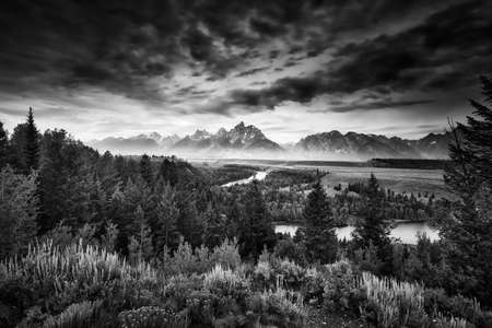 Misty pre-dawn view of the Snake River Valley in the Tetons photo