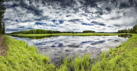 Swan Lake in Grand Teton National Park on a cloudy summer day photo