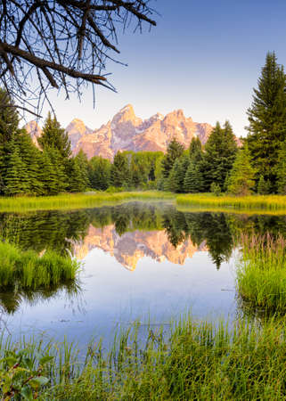 sequester: The Teton ranges reflection upon the Snake River.