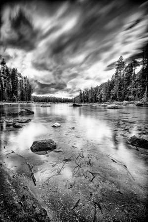smooth: Black and white long exposure photo of Jenny Lake in Grand Teton National Park
