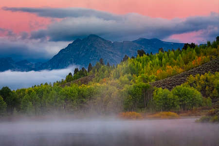 Misty fall foliage on display along the Snake River in Wyoming photo