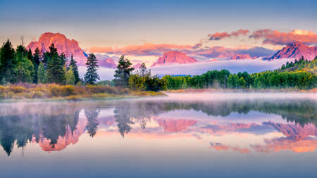 Colorful sunrise on the Snake River in Wyoming photo