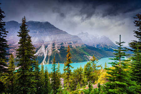 alberta: Vivid torquoise-colored glacial lake under a gloomy sky in Jasper National Park, Alberta, Canada