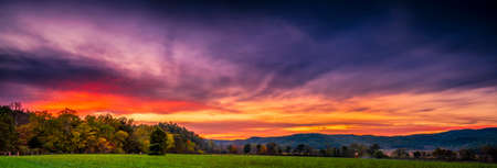 great smoky national park: Autumn sunset panorama of Cades Cove in Great Smoky Mountains National Park Stock Photo