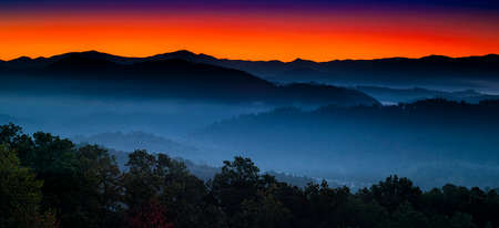 Autumn sunrise view of layered misty mountains  in Great Smoky Mountains National Park photo