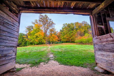 View of fall foliage from within a barn behind the famous John Oliver cabin in the Great Smoky Mountains National Park photo