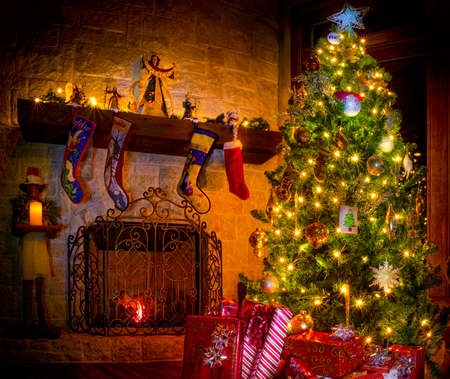 christmas fireplace: Cozy Christmas scene featuring a fireplace, gifts, and a decorated tree Stock Photo