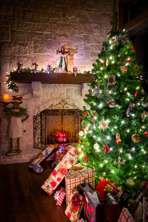 Cozy Christmas scene featuring a fireplace, gifts, and a decorated tree photo