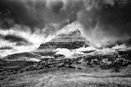 Ominous clouds blanketing the  peaks in Glacier National Park, MT Stock Photo - 25111030