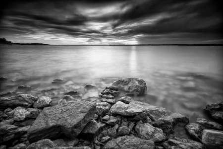 Sunset over a placid lake, monochrome version