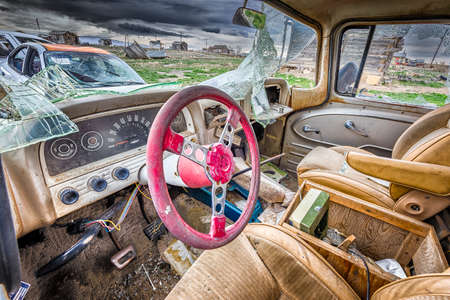 Abandoned, shattered vintage cars in the ghost town of Cisco, Utah photo