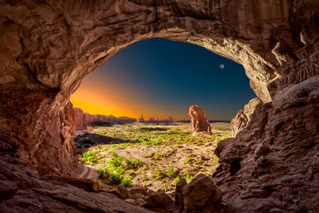 arches national park: Eerie sunrise viewed from inside the Double Arches rock formation in Arches National Park, Utah Stock Photo