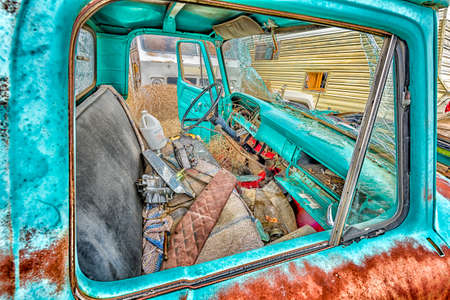 Abandoned, shattered motor vehicles in the ghost town of Cisco, Utah Stock Photo