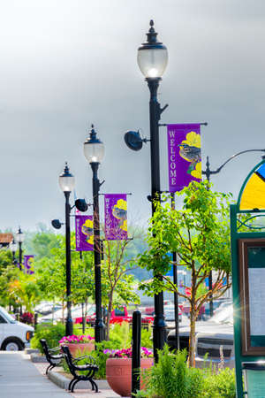 Banners, flowers, and lamp posts adorning main Street in Plattsmouth, Nebraksa on a quiet summer day photo
