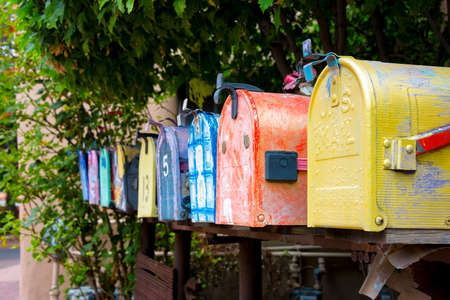 nm: Colorful antique mailboxes on Canyon Road in Santa Fe, NM Stock Photo