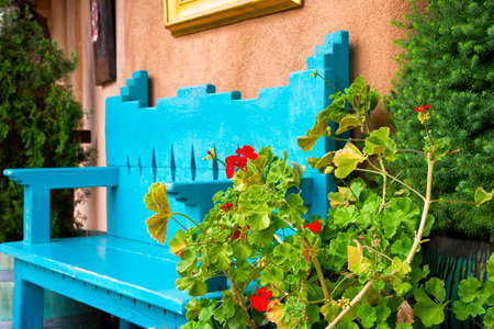 vintage furniture: Red Flowers in Front of an Antique Bench in Santa Fe, NM