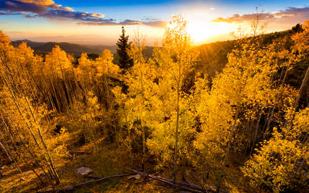 Vivid yellow-golden sunset over the Santa Fe Ski Basin in Northern New Mexico Stock Photo