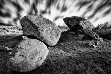 Dramatic long exposure photo of boulders framing Abiquiu Reservior in northern New Mexico
