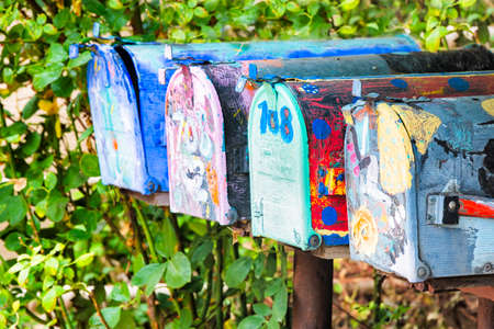 fe: Colorful antique mailboxes on Canyon Road in Santa Fe, NM Stock Photo