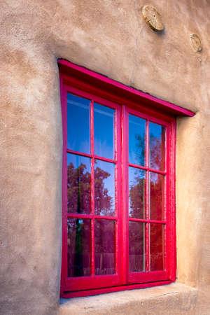 nm: Unique red gallery window in Santa Fe, NM Stock Photo