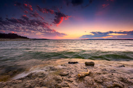 Colorful sunset over Benbrook Lake in North Texas Stock Photo