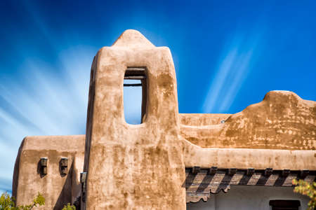 fe: building in Santa Fe, New Mexico with cloud streaks in the sky
