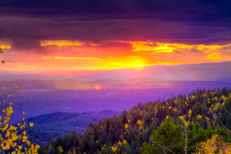 red sunset: New Mexico fall mountain sunset  featuring golden aspens and rays of sunlight