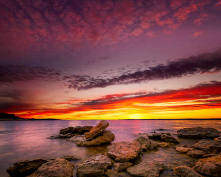 Amazing multicolored sunrise over Benbrook Lake in Fort worth, TX