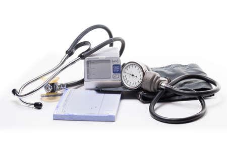 cuffs: Stethoscope, blood pressure cuff, and a wrist pressure cuff on a white background Stock Photo