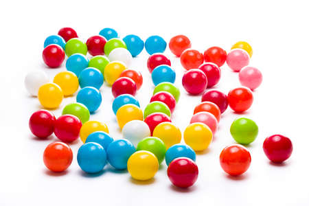 multicolored gumballs: Multicolored gumballs sitting in a white background
