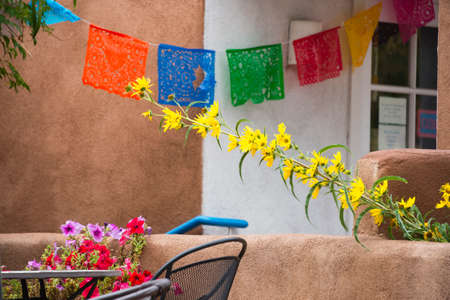 Colorful flowers and decorative napkins seen on Canyon Road in Santa Fe, NM
