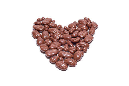 pecans: Chocolate Covered Pecan Pieces Arranged in a Heart Shape Isolated on a White Background Stock Photo