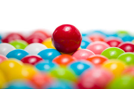 distinguish: Single gumball standing out from the others in a group