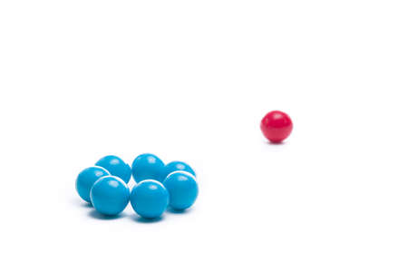 Group of gumballs symbolizing exclusion of one different than themselves Stock Photo