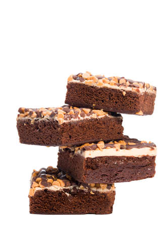 Chocolate peanut butter brownies stacked on a white background photo