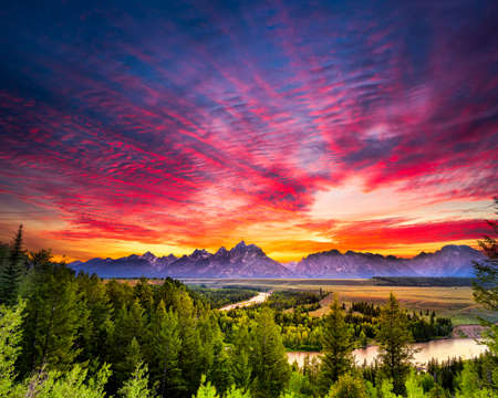 forest river: Colorful sunset at Snake River Overlook in Grand Teton National Park, WY Stock Photo