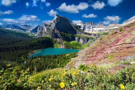 expansive: Expansive view of Grinnell glacier and lower Grinnell Lake on a beautiful Montana summer day Stock Photo