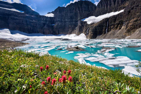 Stunning turquoise colored water at the base of Grinnell Glacier in Glacier National Park, Montana