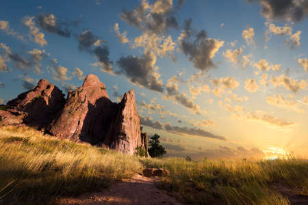red rocks: Dawn over Red Rocks and grass fields in Boulder, CO