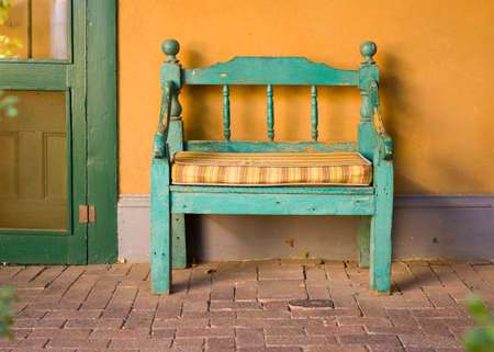 Antique Wooden Bench Outside of a Garden in Santa Fe, NM Stock Photo