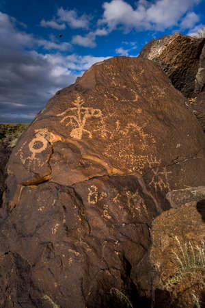 nm: Petroglyphs carved in a large boulder outside Albuquerque, NM