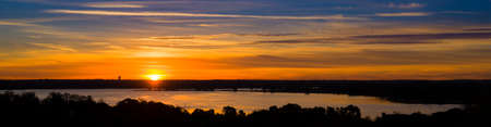 Vivid Texas sunrise over Benbrook Lake with beautiful reflections on the water Фото со стока