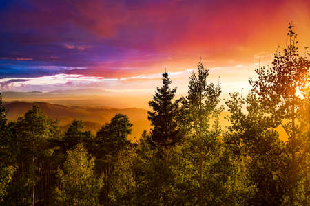 basin mountain: Amazing sunset over the Santa Fe Ski Basin featuring red, orange, blue, yellow, and other colors in the sky