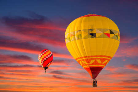 Colorful hot air balloons in flight  illuminated by stunning early morning light