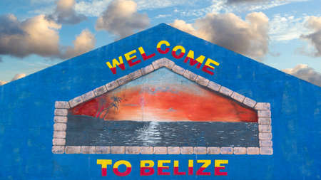 colourful sky: Colorful welcome sign painted on the wall of a building in Belize against a pretty tropical sky Stock Photo